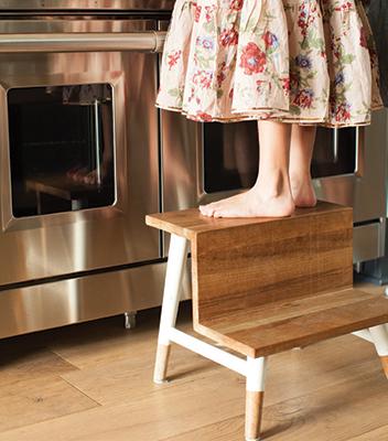 standing on stool